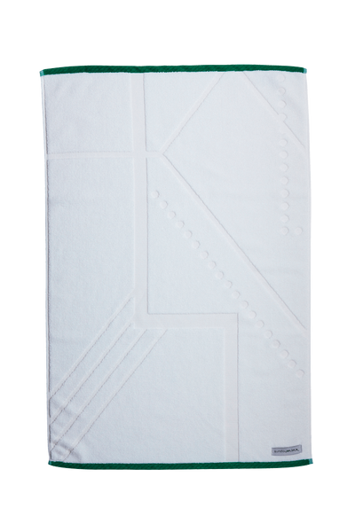 Designer Bath Mat made with Turkish cotton. Pure white in colour with emerald green trim. Features an Art Deco pattern laser cut into the white cotton for a modern decor effect.