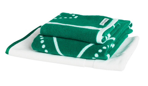 Emerald green and white luxury bath towel bundle with modern Art Deco pattern. Neatly folded Bath Towel, Hand Towels and Bath Mat made with 100% Turkish cotton.