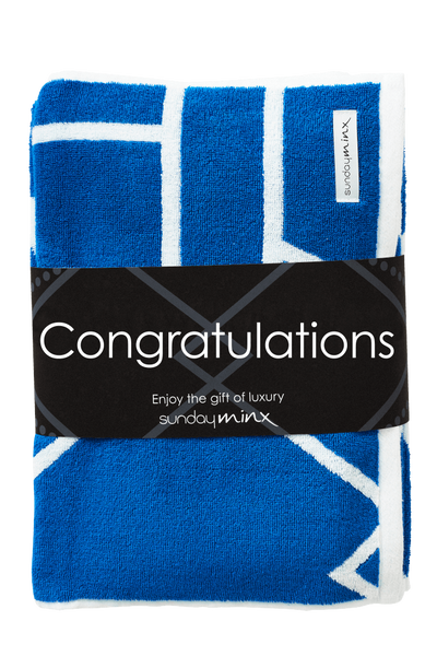 Designer Bath Towel Set including Bath Towel and Hand Towel made with Turkish Cotton. These Turkish Cotton Bath Towels are wrapped with a Congratulations gift band for the perfect gift. Bath Towel Set in blue and white design.