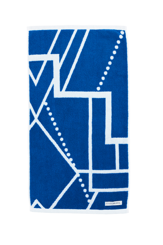 Luxury Hand Towel in azure blue and white. The Breakwater Hand Towel is designed with modern Art Deco patterns and made with 100% Turkish cotton. Side A.