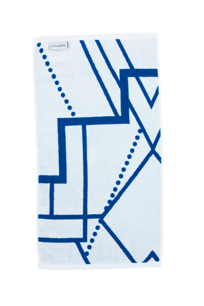 Luxury Hand Towel in azure blue and white. The Breakwater Hand Towel is designed with modern Art Deco patterns and made with 100% Turkish cotton. Side B.