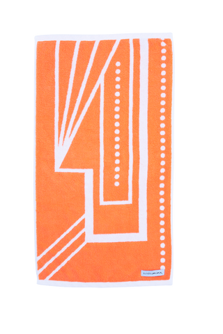 Luxury Hand Towel in vibrant orange and white. The McAlpin Hand Towel is designed with a modern Art Deco pattern and made with 100% Turkish cotton.