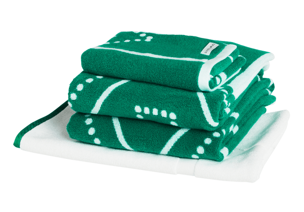Emerald green luxury bath towel set with modern Art Deco patterns. Neatly folded Bath Towels, Hand Towels and Bath Mat made with 100% Turkish cotton.