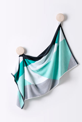 Designer Bath Towel made with Turkish Cotton. Designer colours and geometric pattern in grey, white, green and mint.