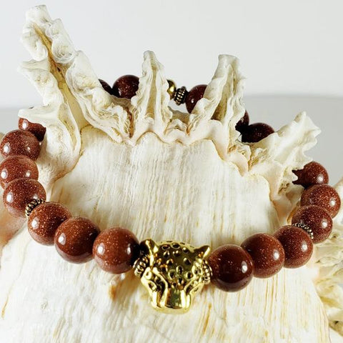 Men's Red Goldstone Beaded Gemstone Stretch Bracelet in Polished 8mm Beads and Antique Gold Plated Leopard Head Bead with Antique Gold Filled Pewter Coiled Heishi Beads