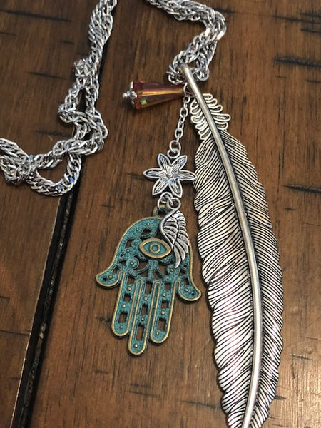 A Hamsa Amulet and Real Metallic Angel Feather-- Youtube Video
