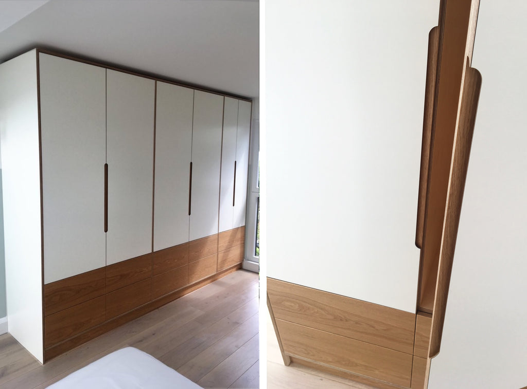 Bespoke fitted wardrobe with white laminate fronts & oak veneer drawers. Designed and made by