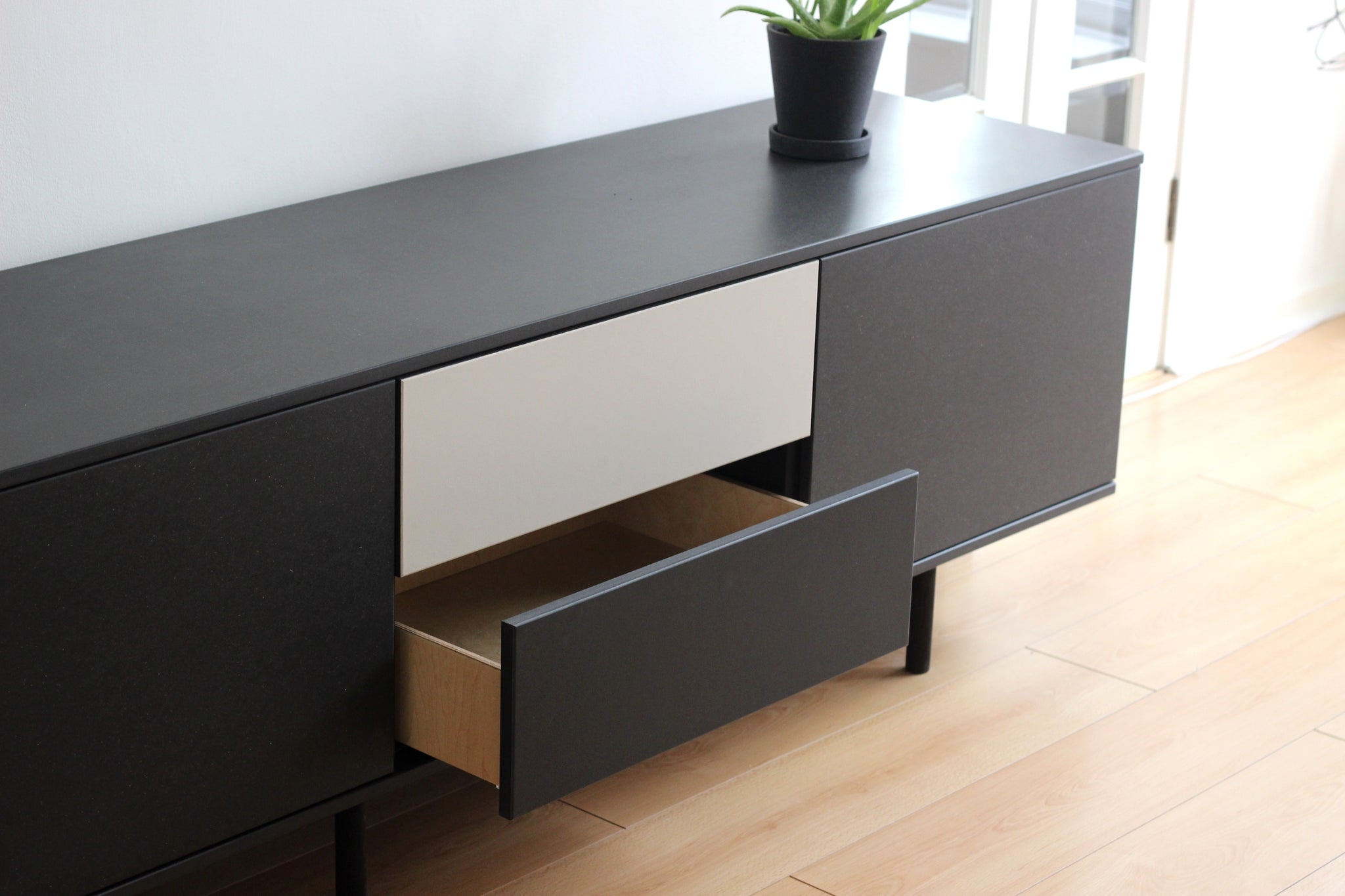 This is a bespoke handmade black Valchromat sideboard made by Jon Grant London in Leyton, East London.