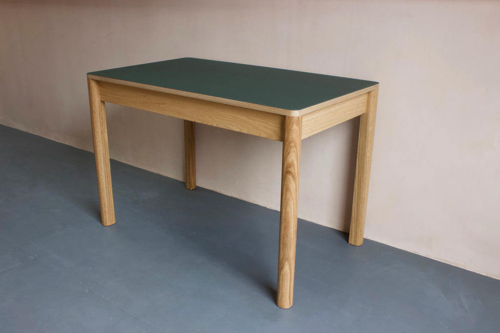 Contemporary Forbo linoleum table is perfect as a dining table or as a modern home office desk. It features Forbo linoleum top with solid oak legs. Choose from variety of Forbo furniture linoleum colour options. Designed and made by Jon Grant London in Leyton, East London.