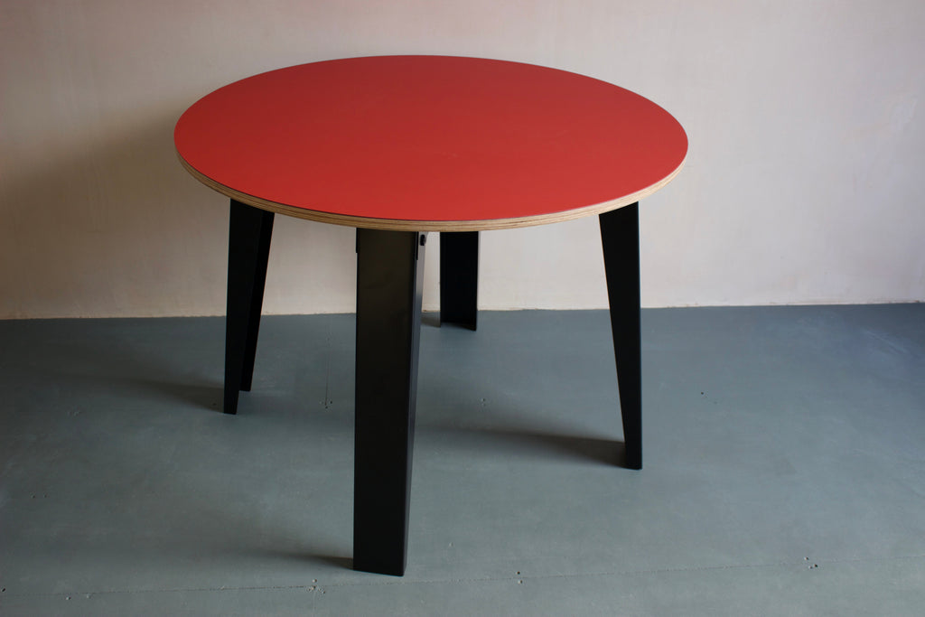This is a designer table for office or your home. It features metal powder coated legs and Forbo lino top. Designed and made by Jon Grant London in Leyton, East London.