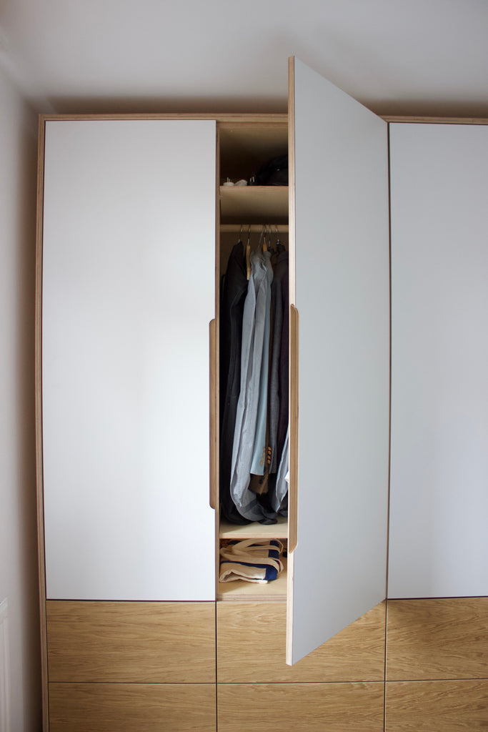 Handmade fitted oak veneer & white laminate plywood wardrobe made by Jon Grant London in Leyton, East London.
