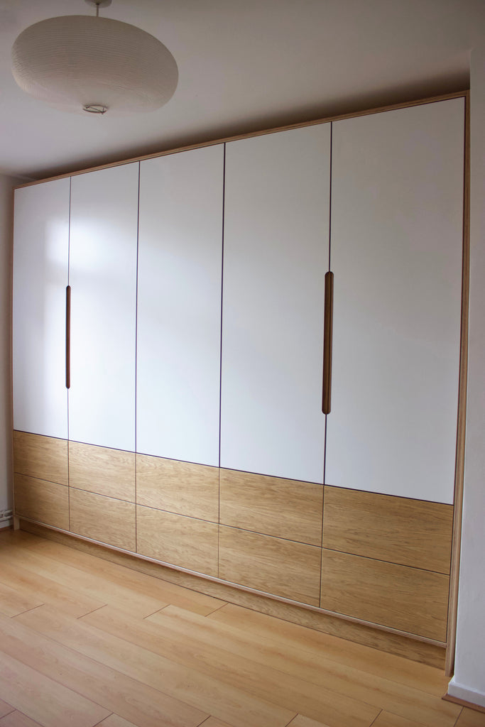 Bespoke fitted oak veneer & white laminate plywood wardrobe made by Jon Grant London in Leyton, East London.