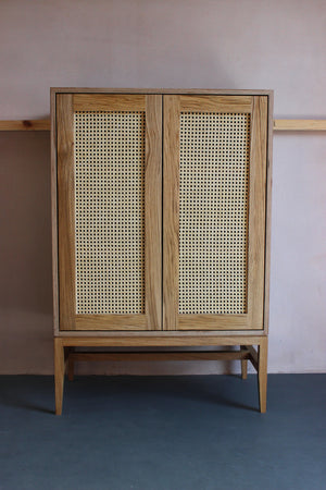 Mid-century style handmade rattan cane cabinet. Perfect for a modern or contemporary house. Designed & made by Jon Grant London in Leyton, East London.