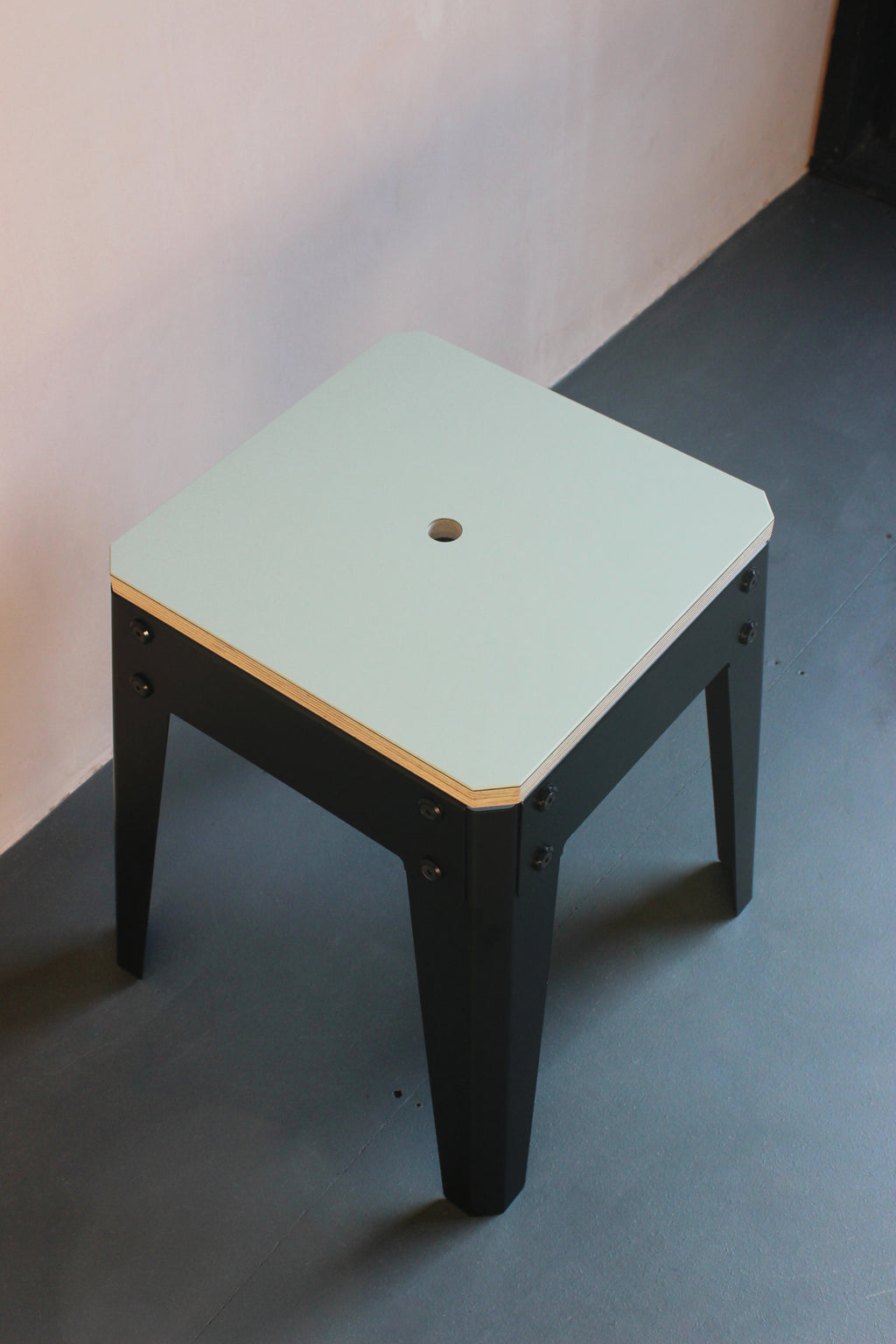 Our low stool is designed and made by Jon Grant London in Leyton, East London. It features metal powder coated legs with Forbo lino top.