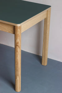 Forbo linoleum table is perfect as a contemporary dining table for family gatherings or as a modern work desk for home. It also features oak veneer frame with solid oak legs. Designed and made by Jon Grant London in Leyton, East London.