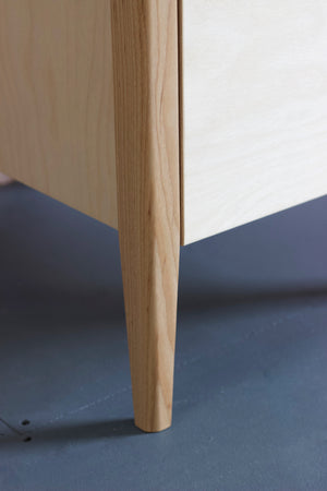 The Huxley birch plywood table featuring solid ash legs. Designed and made by Jon Grant London.