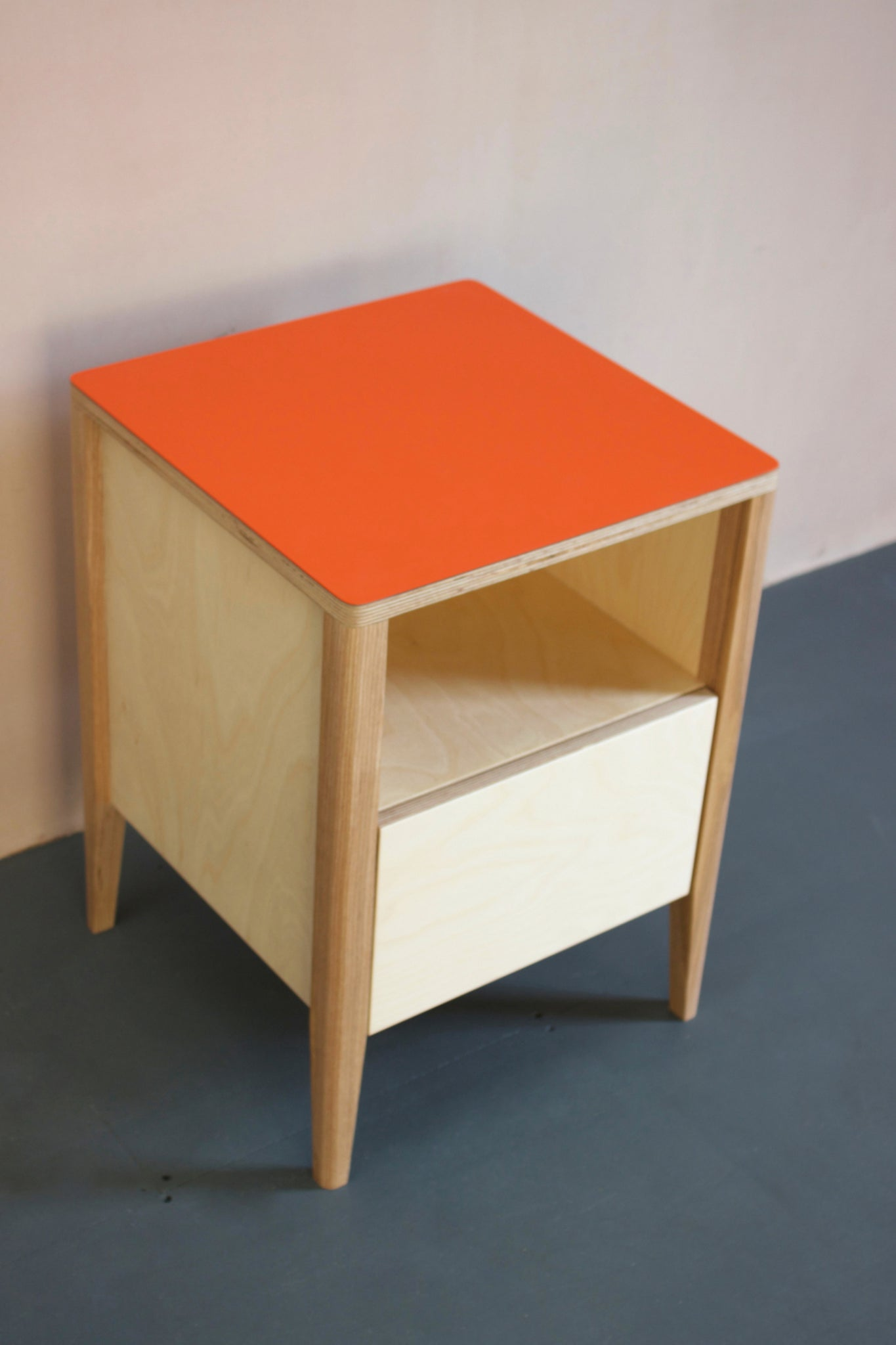 Handmade bedside table- perfect for a modern home. It features Forbo linoleum plywood  top with solid ash legs. Made by Jon Grant London in Leyton, East London.
