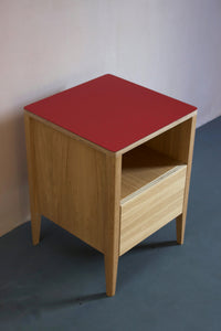 Handmade bedside table, perfect for a modern home. It features Forbo linoleum top with oak veneered plywood carcasses and solid oak legs. Designed & made by Jon Grant London in Leyton, East London.