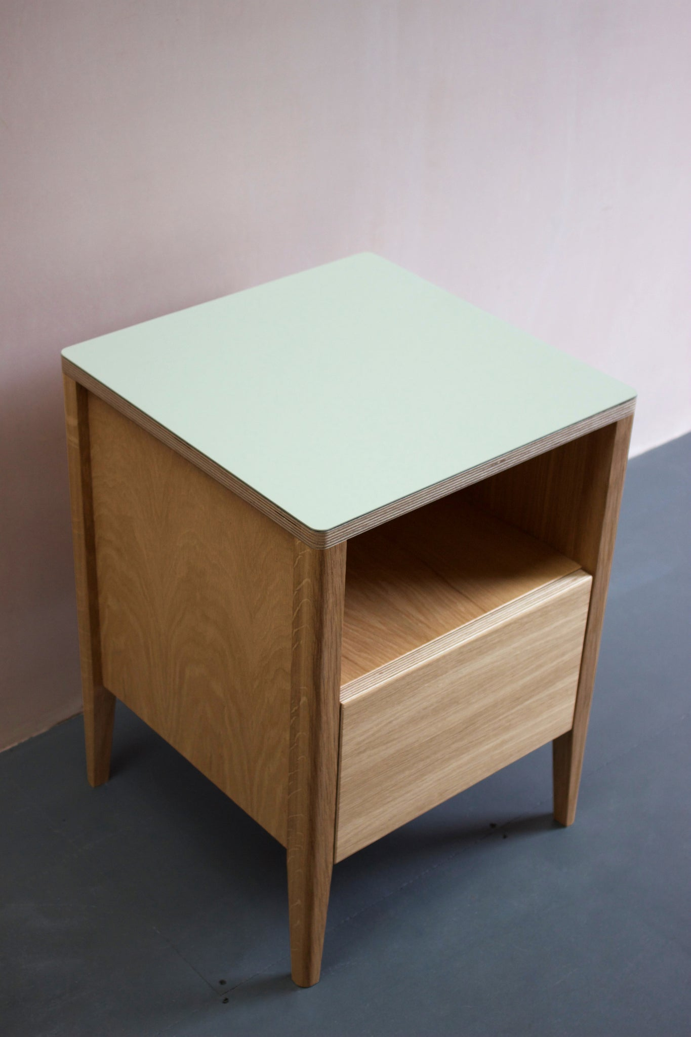 Handmade  bedside table, perfect for a modern home. It features Forbo linoleum top with oak veneered plywood and solid oak legs. Made by Jon Grant London in Leyton, East London.
