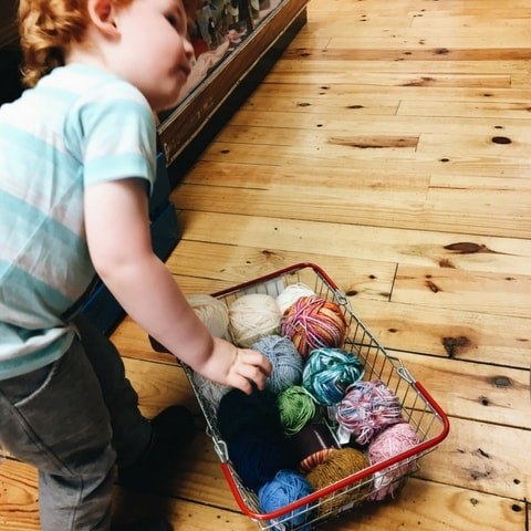 crafting with kids - buying wool from the shop