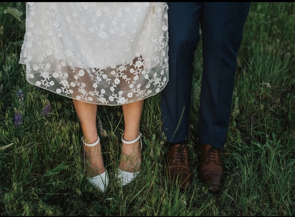 Bride and Groom shoes and daisy dress
