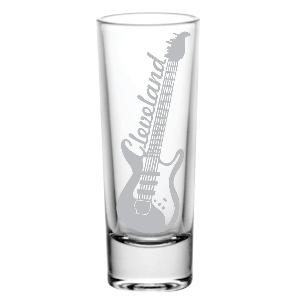 This glass shotglass is laser etched. The image is a guitar with Cleveland on the side and the skyline on the tuner.