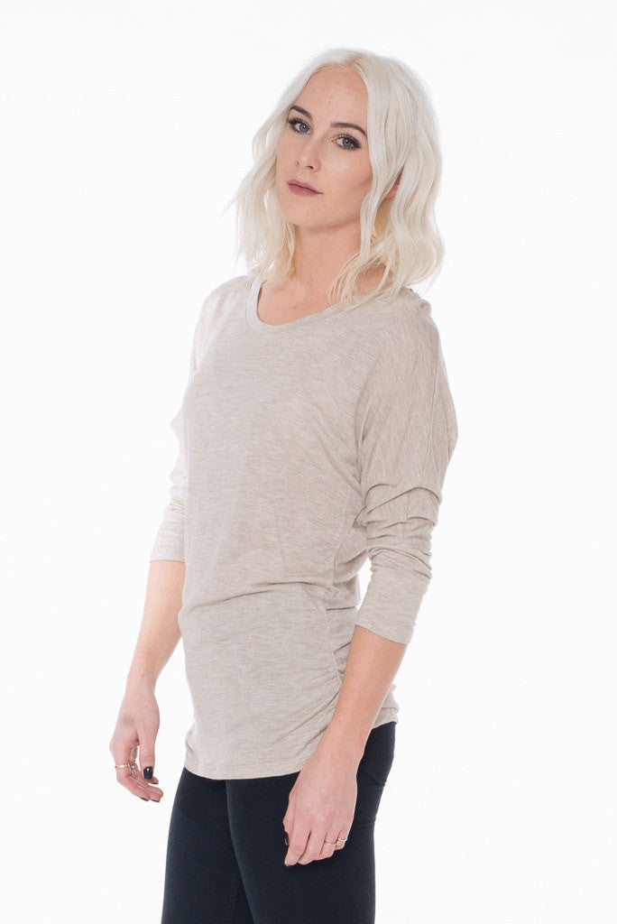 This 3/4 length sleeve and crew neck detail is a perfect layering piece.  It does have a ruching side.