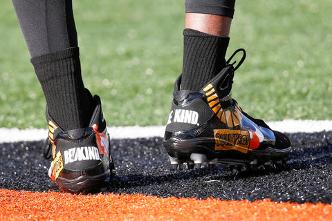 Cincinnati Bengals defensive end Carlos Dunlap wears his specialty cleats for the My Cause My Cleats program during practice before an NFL football game against the Denver Broncos, Sunday, Dec. 2, 2018, in Cincinnati. (AP Photo/Frank Victores)