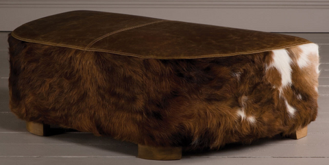 Picture: Rva Creativity Awards - cow leather ottoman. The top of the ottoman is made of smooth grain leather. The sides are made of full grain leather where the hair is still left on.
