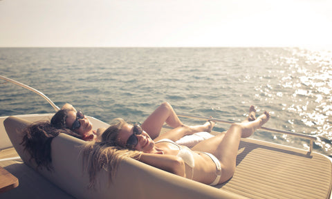girls lounging on the boat