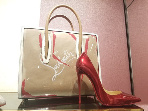 Louboutins red shoe with purse