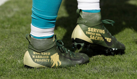 "Carolina Panthers running back Christian McCaffrey (22) with his ""My Cause, My Cleats"" before an NFL football game against the Tampa Bay Buccaneers Sunday, Dec. 2, 2018, in Tampa, Fla. (AP Photo/Chris)"