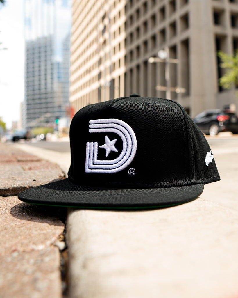 The Original - Classics Snapback in All Black with wing logo.