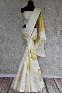 White and Gold Kanjeevaram Saree for Kerala Bride