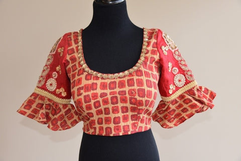 Pure Elegance Printed Orange Blouse with Ruffled Sleeve