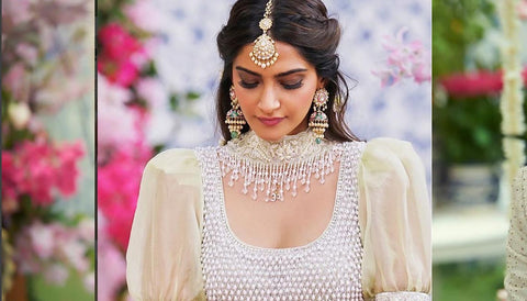 d2541c6a55 Sonam Kapoor brushes off her bridesmaid avatar with a billowy sheer net  blouse that attracts everyone instantly. The statement 80's puff style  sleeves ...