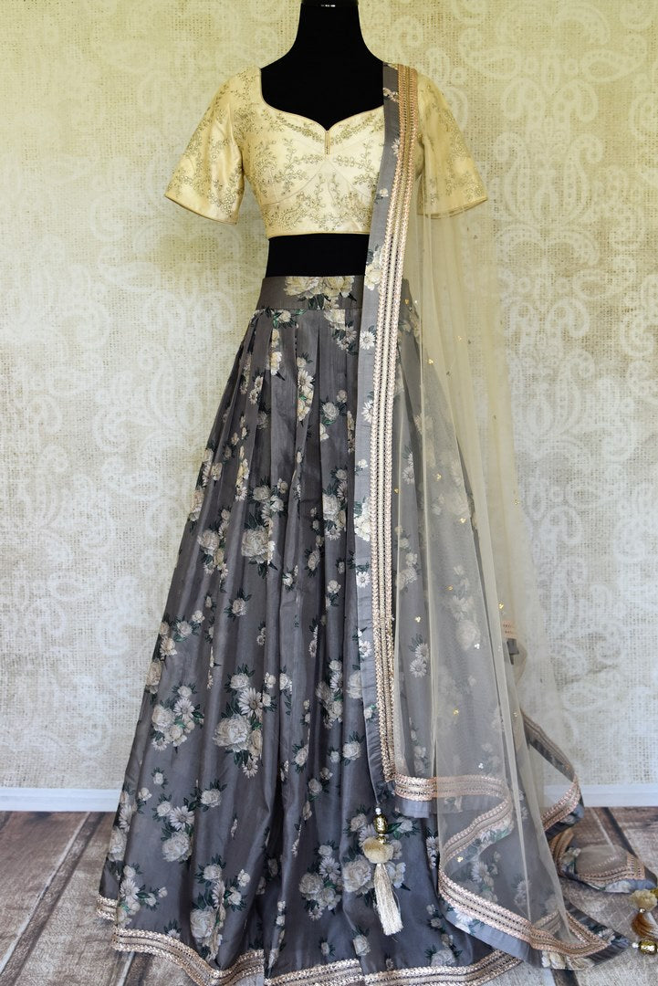 Shop grey and cream printed embroidered lehenga online in USA with dupatta. Get ready to dazzle on weddings and special occasions with an exquisite variety of Indian designer clothes from Pure Elegance Indian clothing store in USA. We have a splendid collection of bridal lehengas, designer sarees, Anarkali suits to make your look absolutely one of kind.-full view