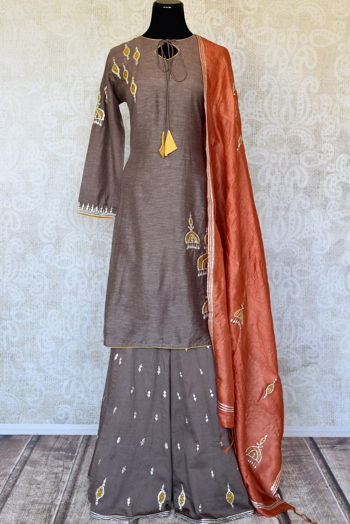 Buy grey applique gota work silk palazzo suit online in USA with dupatta. Keep your wardrobe update with latest Indian clothing from Pure Elegance Indian fashion store in USA. Shop beautiful Indian designer lehengas, Anarkali suits, gowns for Indian women in USA from our online store.-full view