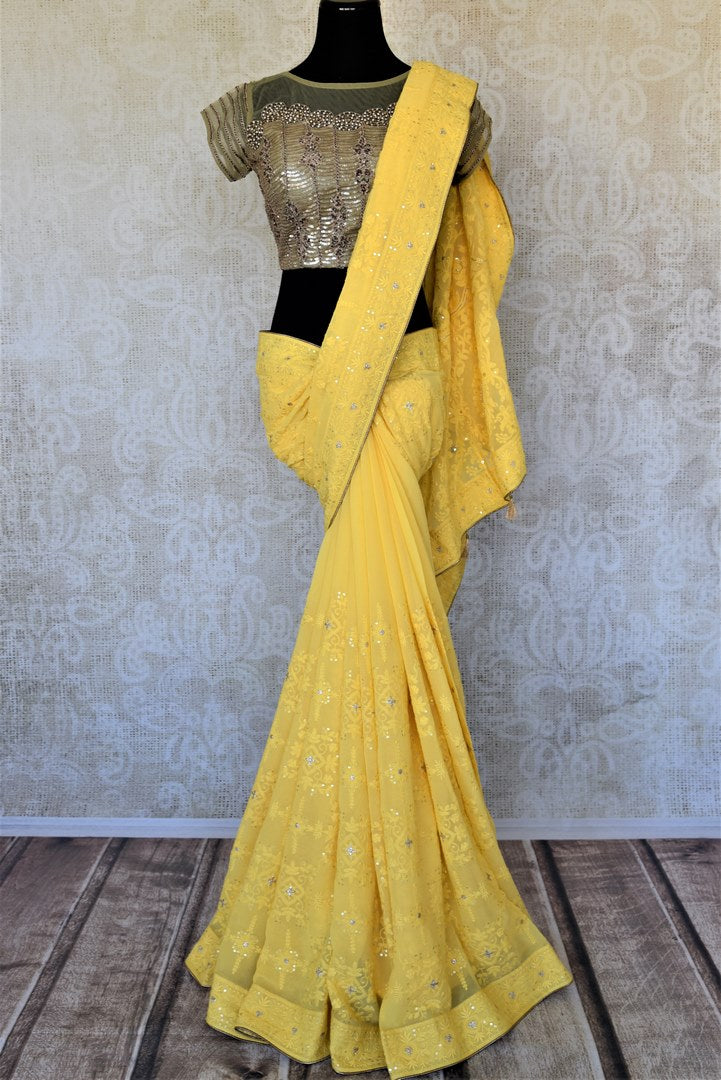 Shop charming yellow Lucknowi embroidery georgette sari online in USA with embroidered saree blouse. Look fashionable at parties and special occasions in contemporary sarees, designer sarees with blouse, embroidered saris from Pure Elegance Indian luxury clothing store in USA.-full view