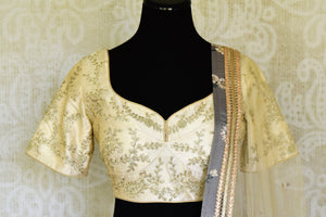 Shop grey and cream printed embroidered lehenga online in USA with dupatta. Get ready to dazzle on weddings and special occasions with an exquisite variety of Indian designer clothes from Pure Elegance Indian clothing store in USA. We have a splendid collection of bridal lehengas, designer sarees, Anarkali suits to make your look absolutely one of kind.-front