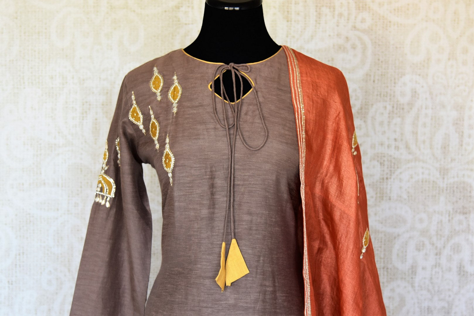 Buy grey applique gota work silk palazzo suit online in USA with dupatta. Keep your wardrobe update with latest Indian clothing from Pure Elegance Indian fashion store in USA. Shop beautiful Indian designer lehengas, Anarkali suits, gowns for Indian women in USA from our online store.-front