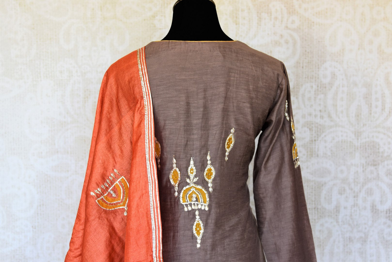 Buy grey applique gota work silk palazzo suit online in USA with dupatta. Keep your wardrobe update with latest Indian clothing from Pure Elegance Indian fashion store in USA. Shop beautiful Indian designer lehengas, Anarkali suits, gowns for Indian women in USA from our online store.-back
