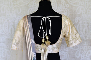 Shop grey and cream printed embroidered lehenga online in USA with dupatta. Get ready to dazzle on weddings and special occasions with an exquisite variety of Indian designer clothes from Pure Elegance Indian clothing store in USA. We have a splendid collection of bridal lehengas, designer sarees, Anarkali suits to make your look absolutely one of kind.-back