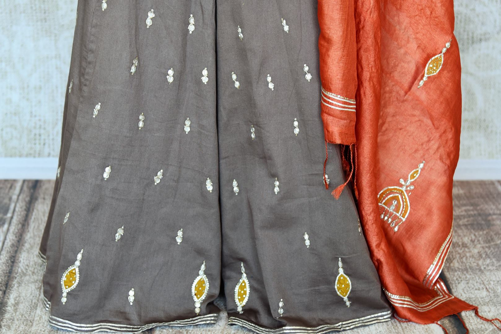 Buy grey applique gota work silk palazzo suit online in USA with dupatta. Keep your wardrobe update with latest Indian clothing from Pure Elegance Indian fashion store in USA. Shop beautiful Indian designer lehengas, Anarkali suits, gowns for Indian women in USA from our online store.-palazzo