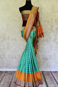 Green Benarasi saree shop online in USA with zari border and geometric pattern. Adorn your style with a range of exquisite handloom sarees from Pure Elegance Indian clothing store in USA. We have an exquisite range of Indian designer sarees, silk sarees, Banarasi sarees and many other varieties also available at our online store.-full view