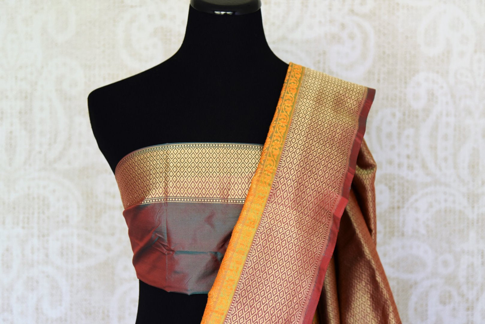 Green Benarasi saree shop online in USA with zari border and geometric pattern. Adorn your style with a range of exquisite handloom sarees from Pure Elegance Indian clothing store in USA. We have an exquisite range of Indian designer sarees, silk sarees, Banarasi sarees and many other varieties also available at our online store.-blouse pallu