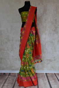 90C111 Vintage floral saree in green color with multi-colored design and red border. The jute Banarasi saree can be bought at our Indian clothing store online in USA - Pure Elegance.