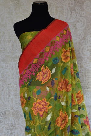 90C111 Charming green and multi-colored vintage floral saree with a red border and tassels on the pallu. The jute Banarasi saree can be bought at our Indian clothing store in USA.