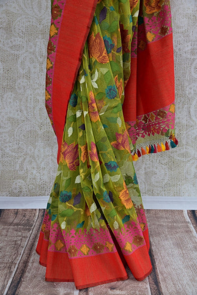 90C111 Vintage floral saree in green color with multi-colored design and red border. The jute Banarasi saree can be bought at Pure Elegance - our ethnic fashion store online in USA.