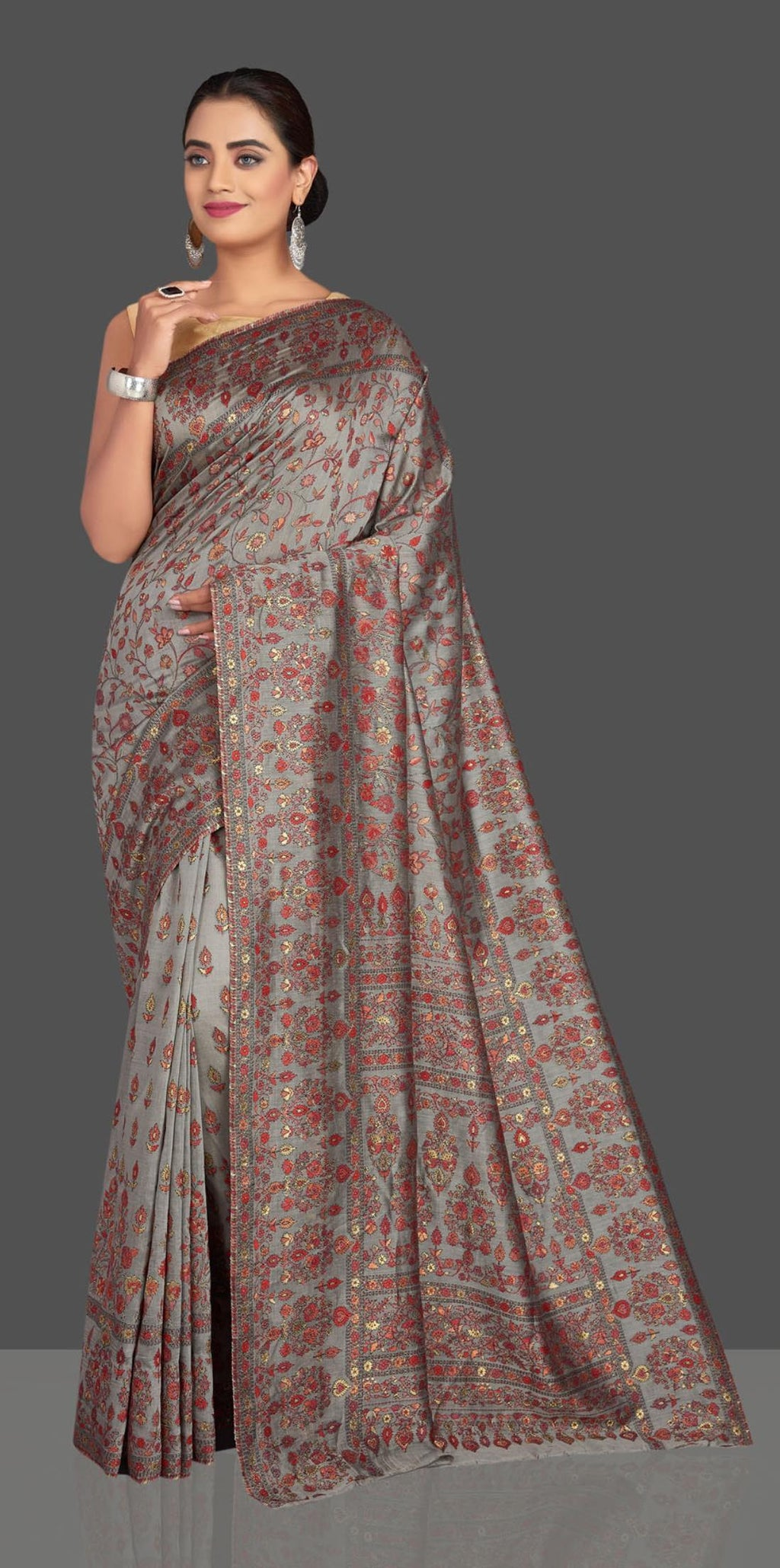 Buy stunning grey Kani weave tussar muga sari online in USA. Shop designer sarees, printed sarees, embroidered sarees, crepe sarees, handwoven silk sarees in USA from Pure Elegance Indian fashion store in USA.-full view